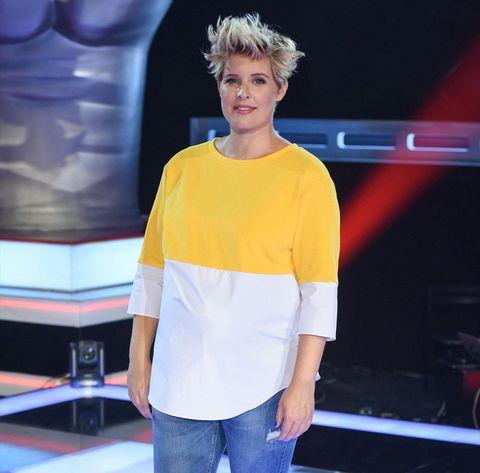 Fashion, Clothing, Yellow, Hairstyle, Shoulder, Fashion show, Fashion design, T-shirt, Human, Sleeve,