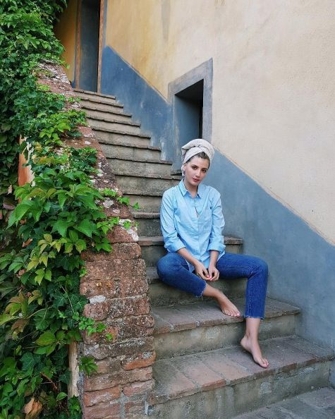 Blue, Sitting, Green, Wall, Denim, Photography, Jeans, Vacation, Textile, Plant,
