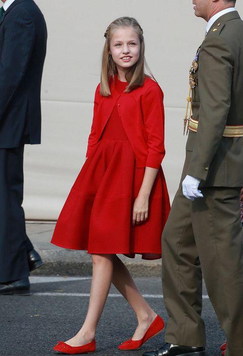 Clothing, Red, Standing, Suit, Fashion, Outerwear, Formal wear, Footwear, Coat, Dress,