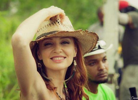 Face, Facial expression, Green, Hat, Smile, Head, Beauty, Fun, Fashion accessory, Sun hat,