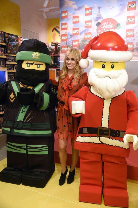 Toy, Decorative nutcracker, Christmas, Fictional character, Santa claus, Lego, Interior design, Mascot, Holiday, Fiction,