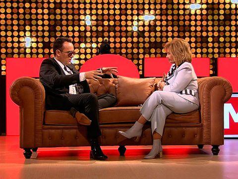 Television program, Couch, Furniture, Leg, Sitting, Comfort, Thigh, Interior design, Chair,