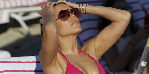 Eyewear, Sun tanning, Glasses, Sunglasses, Muscle, Arm, Summer, Neck, Shoulder, Chest,