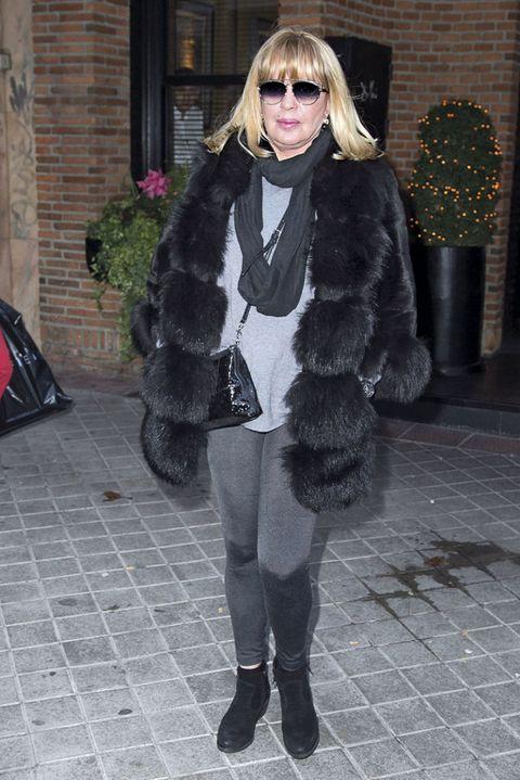 Fur, Clothing, Fur clothing, Street fashion, Fashion, Snapshot, Outerwear, Footwear, Eyewear, Tights,