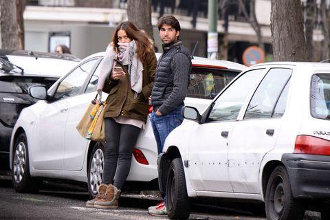 Vehicle, Car, Street, Snapshot, City car, Infrastructure, Road, Pedestrian, Hatchback, Street fashion,