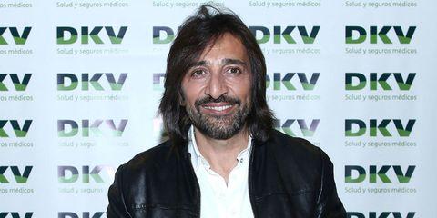 Hair, Facial hair, Beard, Moustache, Long hair, Smile, Fictional character, White-collar worker, Black hair,