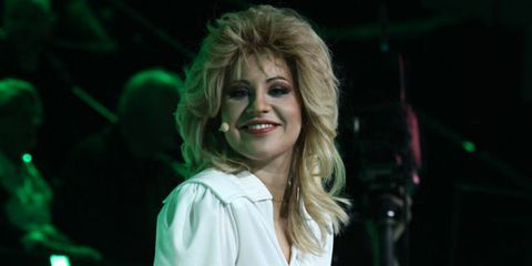 Hair, Face, Green, Blond, Beauty, Performance, Human, Smile, Fun, Mouth,