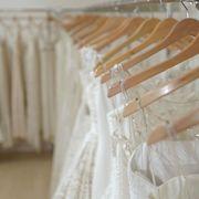 Textile, Linens, Beige, Ivory, Peach, Clothes hanger, Wedding dress, Transparent material, Window treatment, Home accessories,