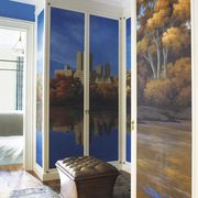 """Hand-painted wallpaper depicting Central Park, and a Tibetan rug in the dressing room of a <a target=""""_blank"""" href=""""http://www.elledecor.com/design-decorate/interiors/a-victorian-townhouse-gets-a-radiant-update-a-69536"""">Manhattan townhouse decorated by Sheila Bridges</a>."""