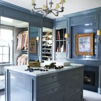 """In a <a target=""""_blank"""" href=""""http://www.elledecor.com/design-decorate/house-interiors/g239/tailored-to-perfection-70109/"""">Manhattan apartment designed by Celerie Kemble</a>, the dressing room painting is by André Dunoyer de Segonzac, and the chandelier and sconces are by <a href=""""http://www.circalighting.com/"""" target=""""_blank"""">Visual Comfort &amp&#x3B; Co</a>."""