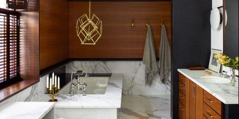 Proof that serious art looks great in bathrooms: This Harry Bertoia sculpture hangs above the