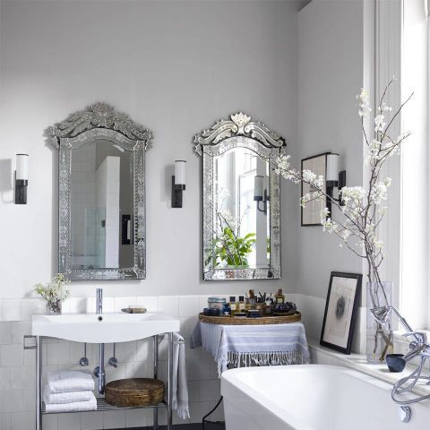 "Swap out telltale frameless, rectangular builder-grade mirrors with more interesting shapes, like these antique Italian versions in a <a href=""/design-decorate/house-interiors/g1020/mishaan-soho-loft/"">Soho loft</a>."