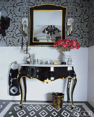 "Swap out a basic vanity in favor of something more dramatic, like this black-laquer-and-gold-leaf version in <a href=""/celebrity-style/celebrity-homes/g1835/at-home-with-anna-sui/"">Anna Sui's bathroom</a>."