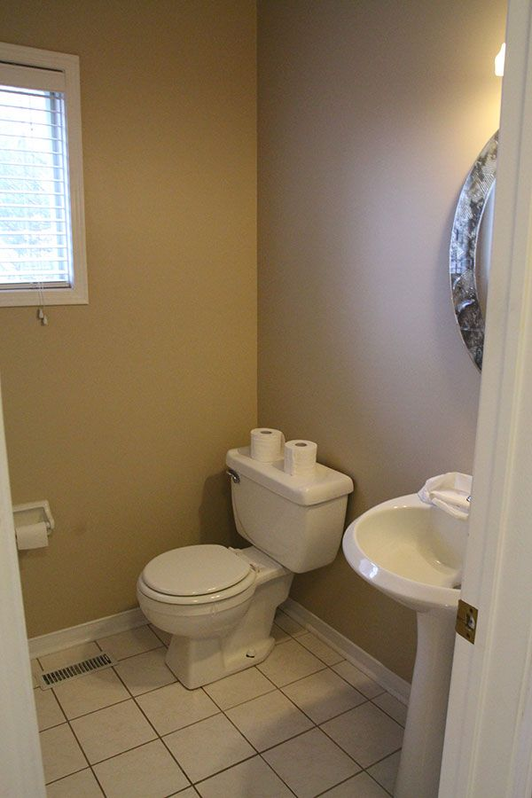 Before & After: A Blah Powder Room Gets a Moody Makeover