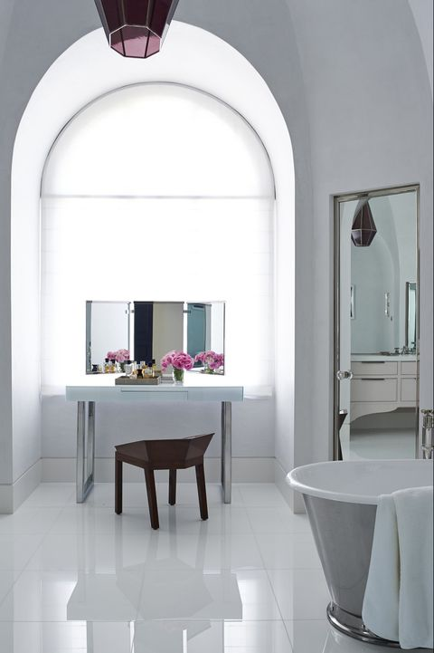 In Loughlin's bathroom, the vanity and chair are custom designs, the tub is by