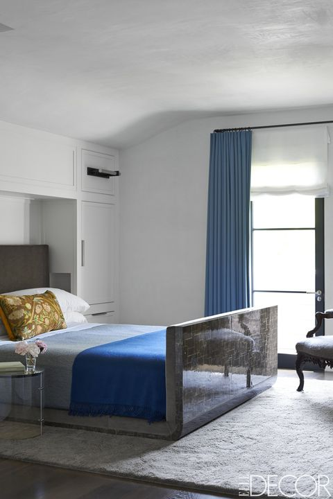 the bed in the master bedroom was designed by maine design the sheets and blanket - Bedroom Rug