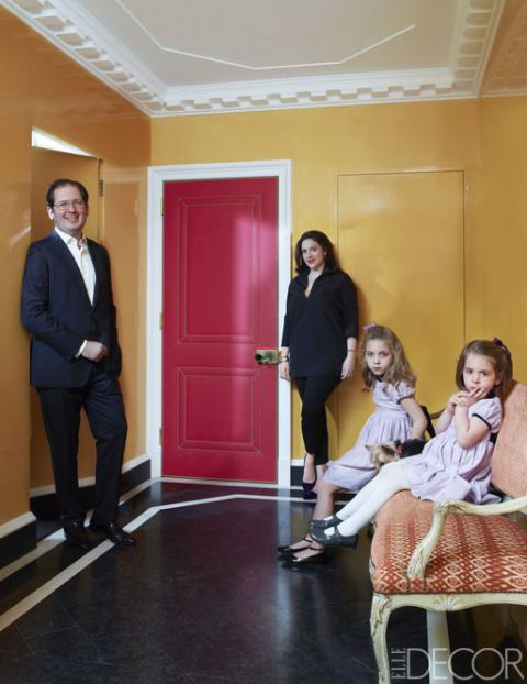 <p>The Brodskys with their daughters, Beatriz (left) and Frederica, and dog, Lucy, in the entry, which is painted in Farrow & Ball's Orangery with a door upholstered in a Dualoy leather.</p>