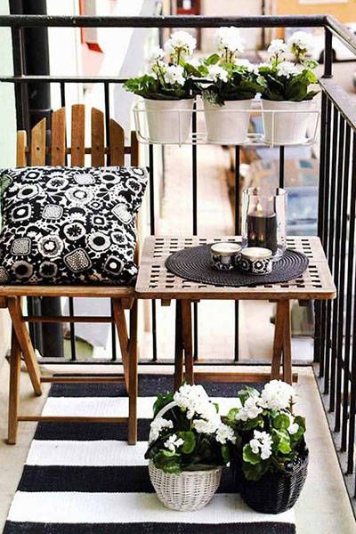 "A multitude of accessories turn this tiny balcony into the perfect spot to enjoy a cup of coffee or relax with a good book. A simple black and white color scheme keeps a lot of design elements from overwhelming a small space.  <a target=""_blank"" href=""http://www.harpersbazaar.com/culture/interiors-entertaining/advice/g4278/awkward-home-space-decor/?slide=1""><em>From Harper's Bazaar</em></a>"