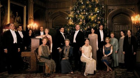 Lighting, People, Event, Social group, Suit, Formal wear, Interior design, Suit trousers, Interior design, Christmas decoration,