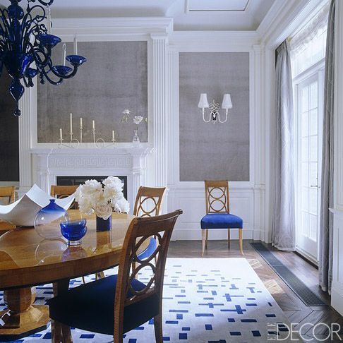The dining room walls are inset with velvet, the sconce is 1940s by Rene Prou and the silk rug is designed by Diamond and Baratta