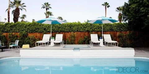 Swimming pool, Property, Water, Resort, Furniture, Real estate, Outdoor furniture, Sunlounger, Chair, Arecales,