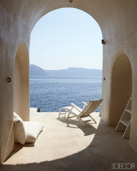 Outdoor furniture, Arch, Azure, Sunlounger, Sea, Shade, Daylighting, Armrest, Chaise longue, Throw pillow,