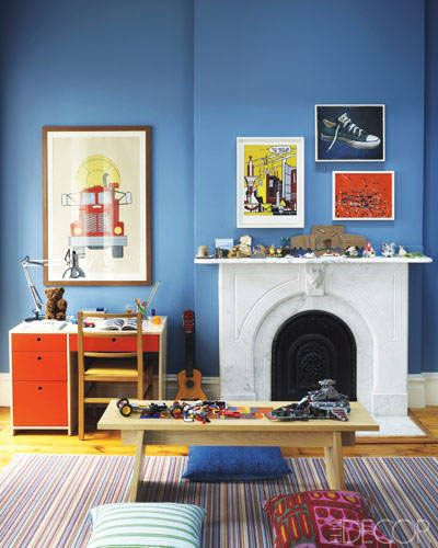 In The Son S Room Of A Family S Victorian Townhouse Designed By Sheila Bridges Colorful Art Hangs Above A Mantel Lined With A Collection Of Toys