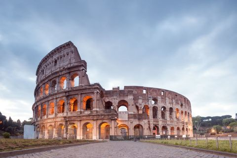 Architecture, Cloud, Arch, Landmark, Amphitheatre, Ancient history, Monument, Ancient roman architecture, Wonders of the world, Historic site,