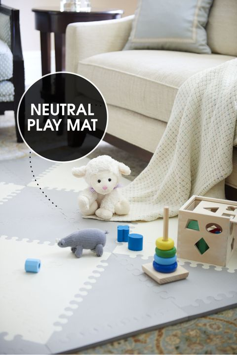 "<p>Move the coffee table aside and give your newest addition room to roam. A diamond-patterned play mat (made of interlocking foam tiles) feels plush beneath crawling hands and knees and provides traction for toddling feet. Its neutral color blends in with the other living room accessories.</p><p><em>Skip Hop foam floor tiles, <a href=""http://www.skiphop.com/product/playspotgeo.html"" target=""_blank"">skiphop.com</a>; knit rhino rattle, <a href=""http://www.estella-nyc.com/organic-rhino-rattle-baby-toy.html"" target=""_blank"">estella-nyc.com</a>; other toys, </em><a href=""http://www.melissaanddoug.com/"" target=""_blank""><em>melissaanddoug.com</em></a></p>"