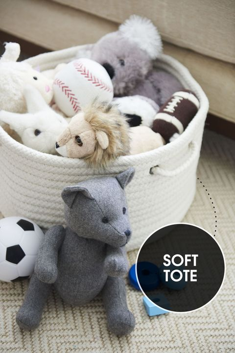 "<p>A soft, lidless tote is a chic way to corral baby toys like stuffed animals and blocks—and whisk them away when playtime is over. Down the road, it becomes a cute container for magazines, beach towels and more. </p><p><em>Toys, </em><a href=""http://www.melissaanddoug.com/"" target=""_blank""><em>melissaanddoug.com</em></a><br></p>"