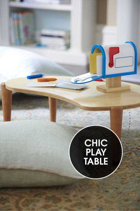 "<p>Sitting less than 10 inches off the floor, a legume-shaped wood table gives the under-six set a surface to play on, yet dovetails nicely with your grown-up décor. </p><p><em>IglooPlay Lima table, <a href=""http://www.iglooplay.com/lima-table-allwood.html"" target=""_blank"">iglooplay.com</a>; My Own Mailbox and learning mat crayons, <a href=""http://www.melissaanddoug.com/"" target=""_blank"">melissaanddoug.com</a></em></p>"