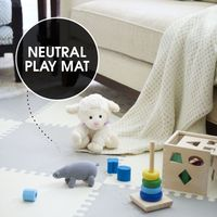 "<p>Move the coffee table aside and give your newest addition room to roam. A diamond-patterned play mat (made of interlocking foam tiles) feels plush beneath crawling hands and knees and provides traction for toddling feet. Its neutral color blends in with the other living room accessories.</p><p><em>Skip Hop foam floor tiles, <a href=""http://www.skiphop.com/product/playspotgeo.html"" target=""_blank"">skiphop.com</a>&#x3B; knit rhino rattle, <a href=""http://www.estella-nyc.com/organic-rhino-rattle-baby-toy.html"" target=""_blank"">estella-nyc.com</a>&#x3B; other toys, </em><a href=""http://www.melissaanddoug.com/"" target=""_blank""><em>melissaanddoug.com</em></a></p>"
