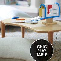 """<p>Sitting less than 10 inches off the floor, a legume-shaped wood table gives the under-six set a surface to play on, yet dovetails nicely with your grown-up décor.</p><p><em>IglooPlay Lima table, <a href=""""http://www.iglooplay.com/lima-table-allwood.html"""" target=""""_blank"""">iglooplay.com</a>&#x3B; My Own Mailbox and learning mat crayons, <a href=""""http://www.melissaanddoug.com/"""" target=""""_blank"""">melissaanddoug.com</a></em></p>"""