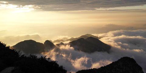 Mountainous landforms, Sky, Cloud, Highland, Atmosphere, Atmospheric phenomenon, Mountain range, Hill, Mountain, Ridge,