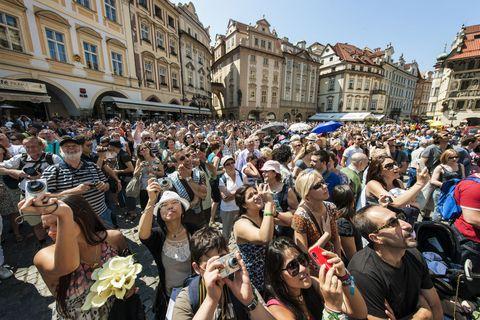 Arm, Crowd, People, Audience, Tourism, Block party, Public event, Town square, Party, Fan,