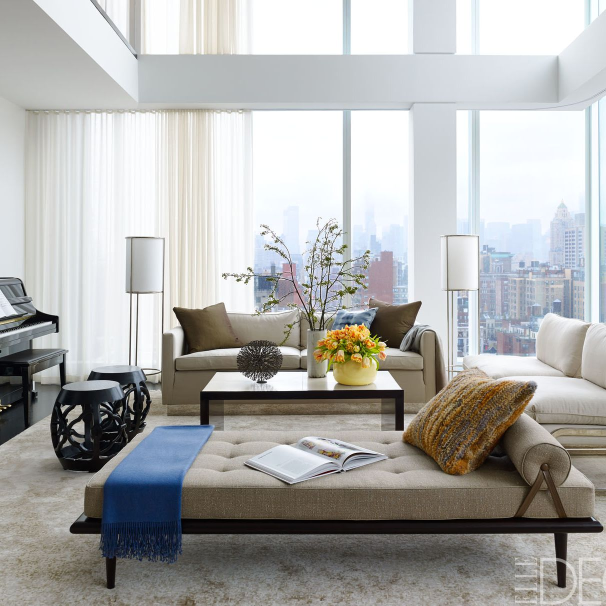 <p>In the living room of David and Laurie Rosenblatt's Upper East Side Manhattan duplex, which was designed by architect S. Russell Groves, the daybed, covered in an Hermès fabric, and sofa, in a Great Plains fabric, are custom made, the Milo Baughman-style chairs are covered in a Great Plains linen, and the cocktail table is by Roman Thomas&#x3B; the light sculpture over the piano is by Soledad Arias, the rug is by Fort Street Studio, and the walls are painted in Benjamin Moore's Decorators White.</p>