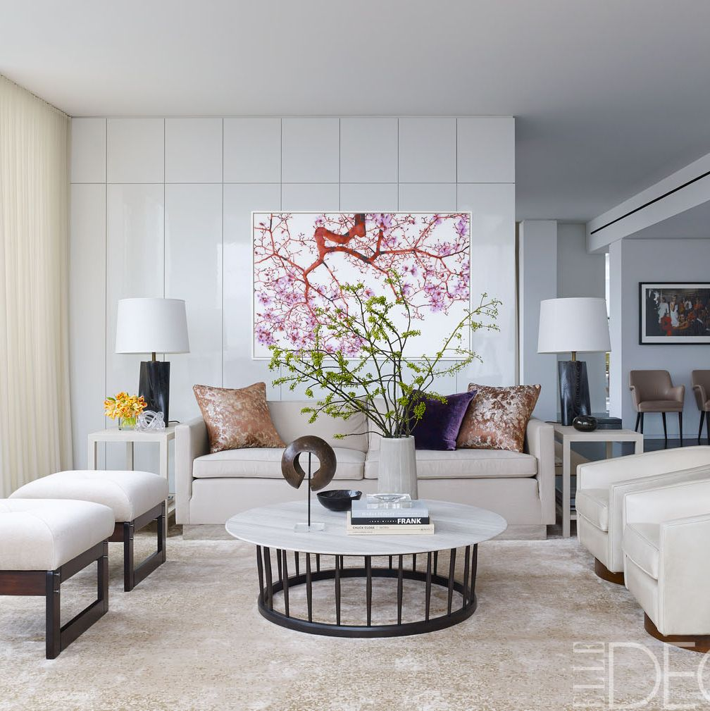 <p>In the living room, the swivel chairs' upholstery is by Jerry Pair Leather and the vintage ottomans are covered in a Great Plains mohair&#x3B; the painting is by Jackie Battenfield.</p>