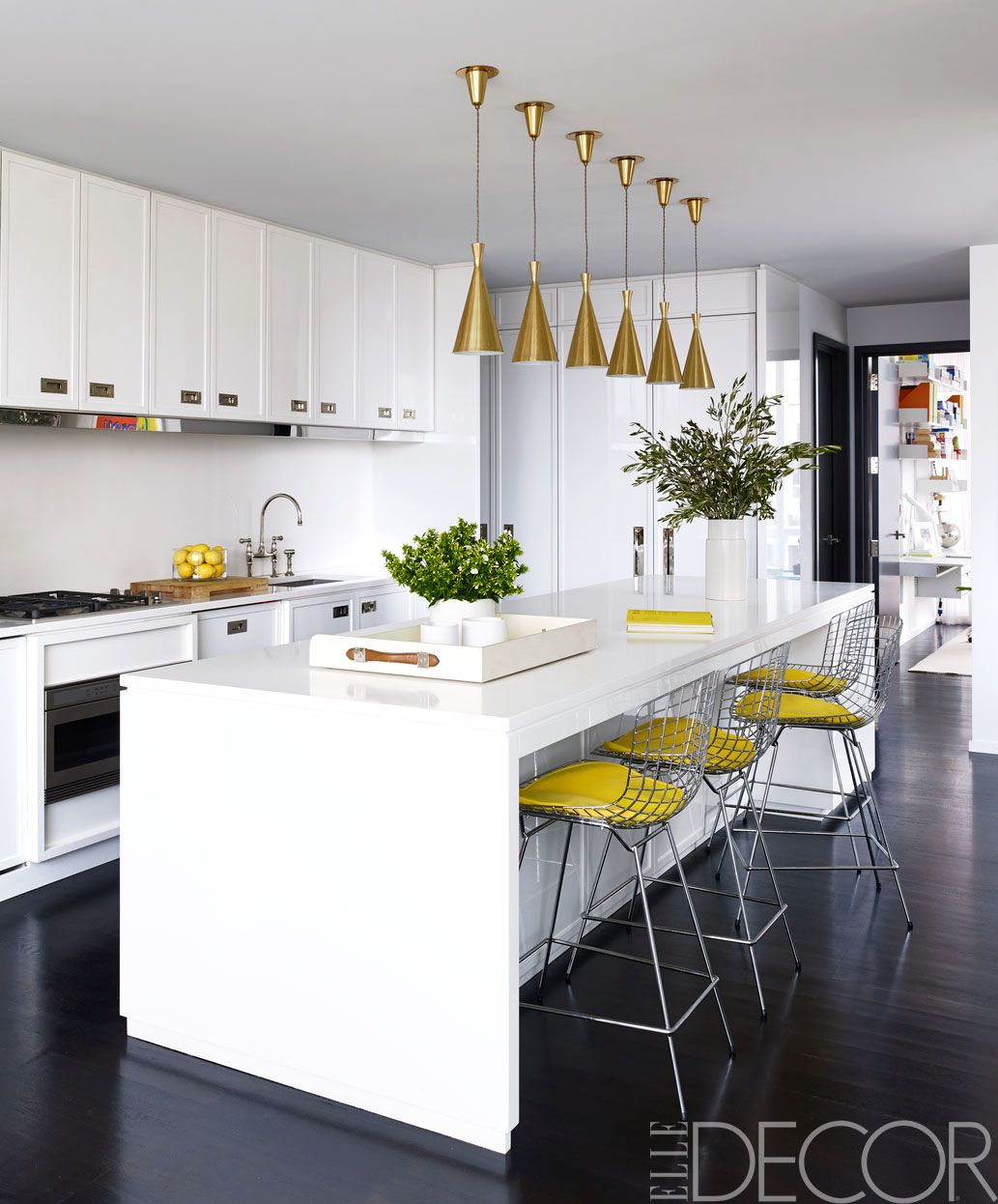 The Kitchen Island And Counters Are Topped With A Caesarstone Surface, The  Bertoia Barstools Are