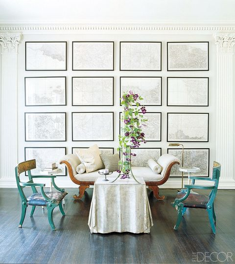 "<p>In the sitting area of John Dransfield and Geoffrey Ross's Somerset, New Jersey, home, the wall of a sitting area is filled with framed French military maps that date back to the 19th century and were commissioned by Napoléon III.</p><p><a href=""http://www.elledecor.com/home-remodeling-renovating/home-makeovers/g1576/a-classic-revival/"" target=""_blank"">Tour the rest of the home.</a></p>"