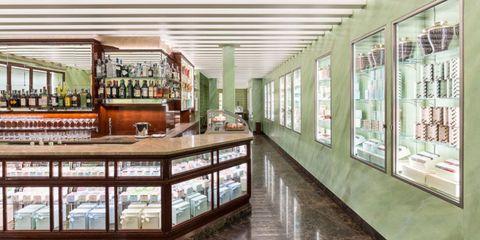 Glass, Interior design, Bottle, Ceiling, Floor, Glass bottle, Drink, Fixture, Alcoholic beverage, Distilled beverage,