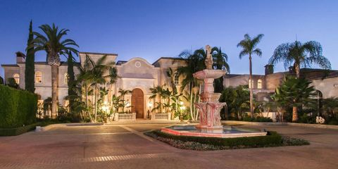 Plant, Property, Tree, Real estate, Arecales, Fountain, Water feature, Garden, Palm tree, Mansion,