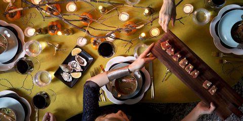 Serveware, Hand, Dishware, Drink, Kitchen utensil, Dish, Circle, Saucer, Porcelain, Meal,