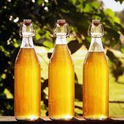 Liquid, Fluid, Drink, Yellow, Bottle, Glass bottle, Drinkware, Amber, Alcoholic beverage, Bottle cap,
