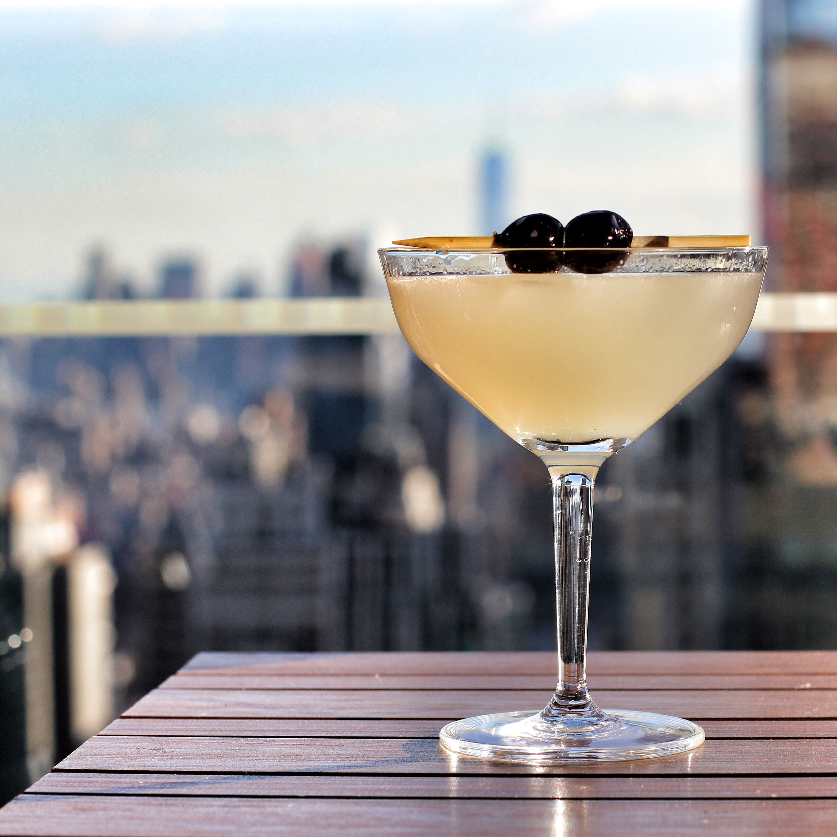 <p>Another one from Bar 54, this cocktail features lemon and triple sec for a delicious fruity drink. But don't be fooled—it packs a punch with gin, Lillet, and absinthe. </p><p><strong>Ingredients: </strong></p><p>1 oz gin </p><p>1 oz Lillet </p><p>1 oz cointreau (triple sec)</p><p>1 oz lemon </p><p>Splash of absinthe</p><p><strong>Directions:</strong></p><p>Shake all ingredients together over ice. Served in a coupe with 2 cherries. </p>