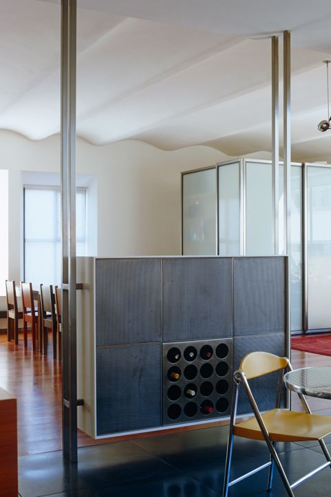 "<p>Replace your simple wine fridge with a fully integrated (non-removeable) storage solution that can stand alone as a statement piece. This wine cooler creatively doubles as a room divider. Go for stainless steel and decorative features that tie into the rest of your kitchen for ""a very modern look,"" advises designer <a href=""http://malcolmjameskutner.com/"" target=""_blank"">Malcolm James Kutner</a>.</p>"