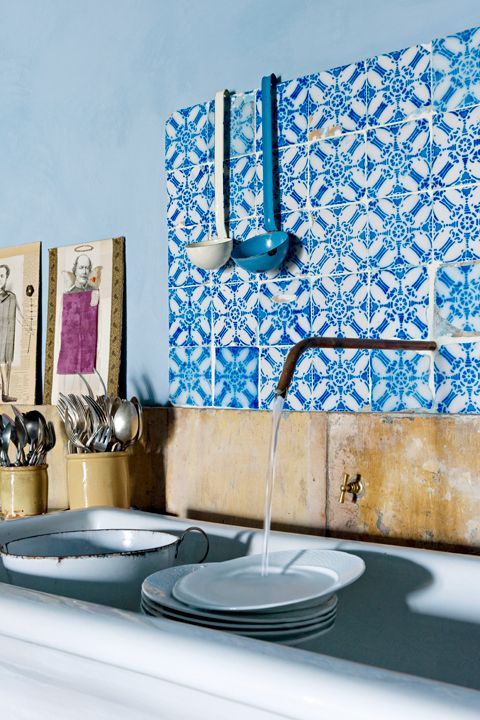 <p>Choose a hand-painted or colorful ceramic tile backsplash for a small area. Or, if the space above your countertop bleeds into a larger wall, consider using a back-painted glass backsplash that complements the color of the wall.</p>