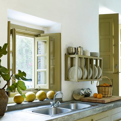 """<p>You don't need to replace them: """"Painting the cabinetry a bright, fun, glossy color is a great way to make a kitchen come alive,"""" says designer <a href=""""http://www.sarastorydesign.com/"""">Sara Story</a>.</p>"""