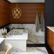 Proof that serious art looks great in bathrooms: This Harry Bertoia sculpture hangs above the tub in the master bath of a Greenwich Village townhouse designed by Joe D'Urso.