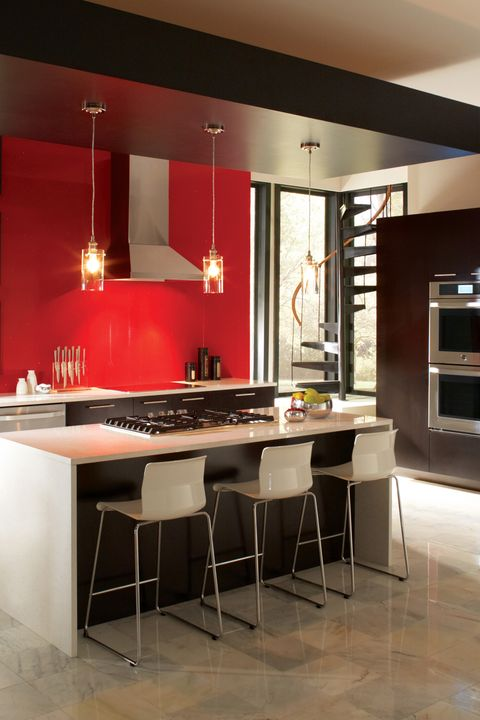 "<p>A daring color from floor to ceiling may be too much in your living room, but it can feel just right in the kitchen. ""I encourage people to go bolder with color if the design will support it because you don't see as much of your wall in a kitchen space,"" says designer <a href=""http://www.laurenlevant.com/"">Lauren Levant Bland</a>.</p>"
