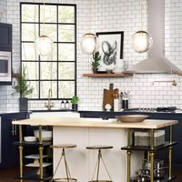 "<p>""A beautiful light fixture adds a whole other layer of design and atmosphere to a kitchen,"" says designer <a href=""http://www.sarastorydesign.com/"" target=""_blank"">Sara Story</a>. And for a softer ambiance, ""Two lamps on either end of an island warm a kitchen up,"" offers designer <a href=""http://www.mcalpineboothferrier.com/"">Susan Ferrier</a>.</p>"